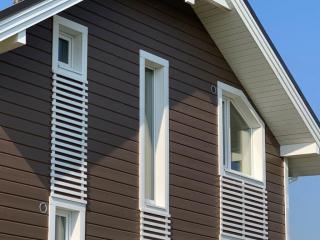 Каркасный дом по проекту КД 023 с террасой в КП «Сосновские Озера», Приозерский район